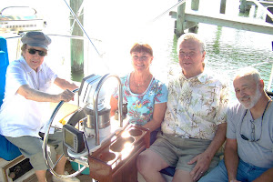Paula's parents (Dora & John) and Aunt Ilene at the helm