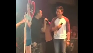 Moymoy Palaboy carrying Yaya DUB's standee while talking to Alden Richards.
