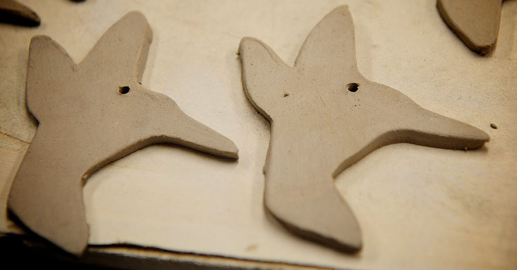Punch a hold in each clay hummingbird shape. You can punch the hole in the top wing, or near the head like I've done here.