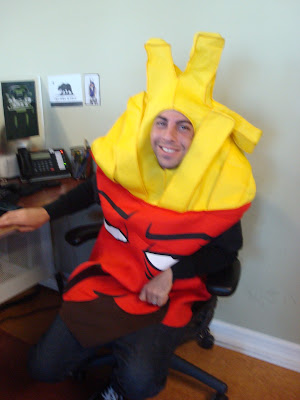 halloween 2011 at gotprint employee wearing fries costume at desk