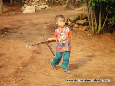 Young Hmong boy with his crossbow