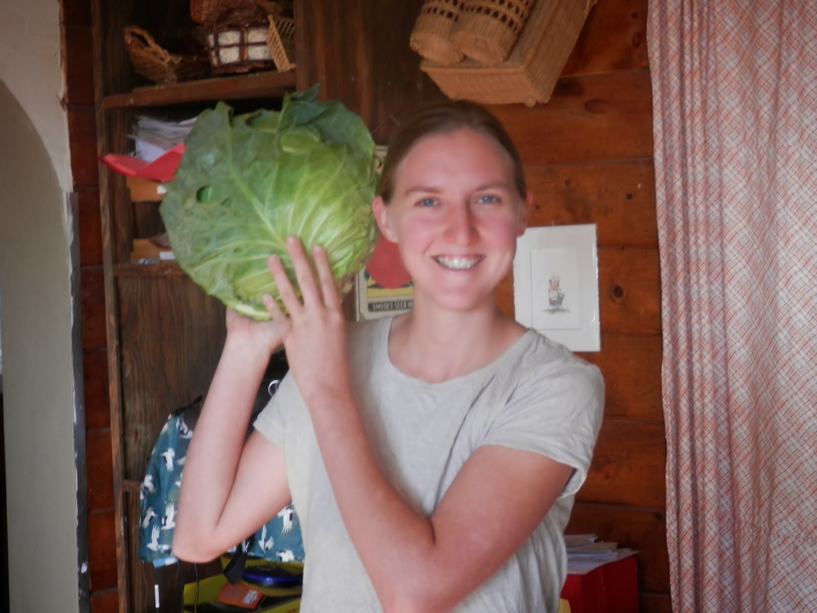 Amber brings cabbage for us.
