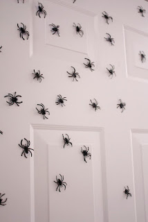 Plastic Spiders on Front Door by Delia Creates