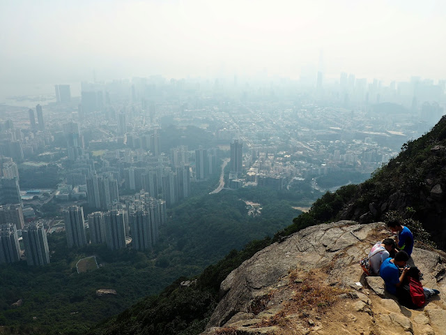 View of Kowloon, with smog and pollution, from the top of Lion Rock, Hong Kong.