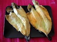 Trucha asalmonada al horno al ajillo
