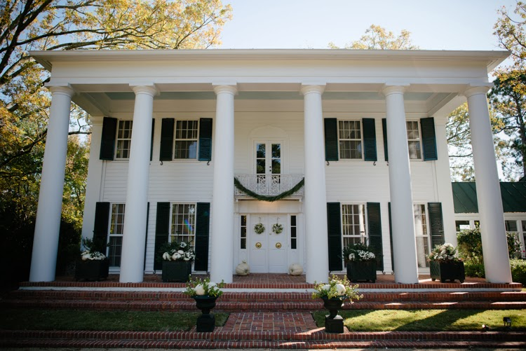 beautiful Mississippi white mansion in starkville with green shutters and tall columns
