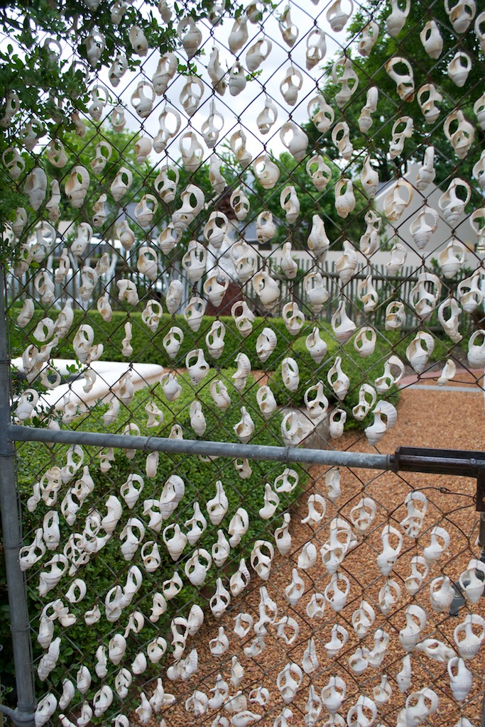 The Clever Use Of Shells Add Decorative Appeal To This Otherwise Plain,  Galvanised Gate, Separating The Front Garden From The Side Garden.