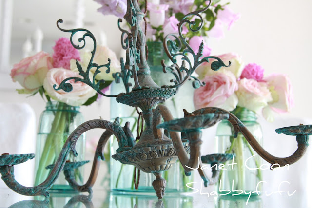 patina on an old chandelier inspired a mason jar chandelier