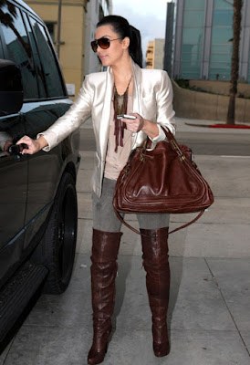 Fashionista Kim Kardashian glamorous style brown thigh high over knee boots outfit.