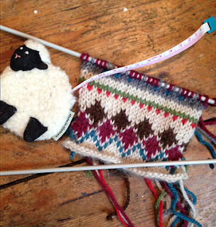 Fair isle swatch plus sheep tape measure