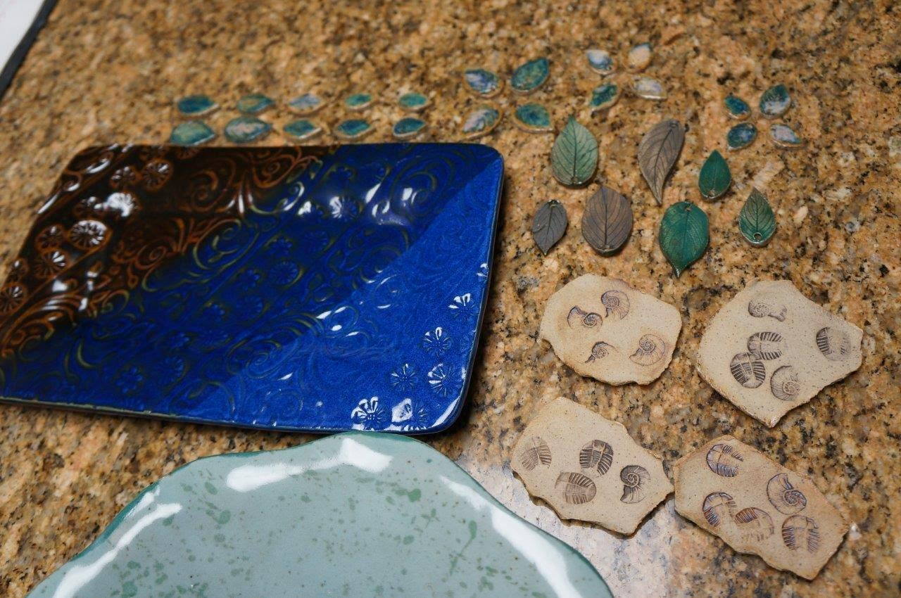 Various beautiful ceramic / stoneware handmade items, including leaves.