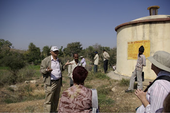 INDIA 2011: Heera explaining the benefits of the past  DWC projects to the group