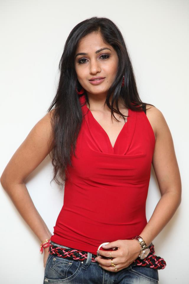 Madhavi latha in red sleeveless tops
