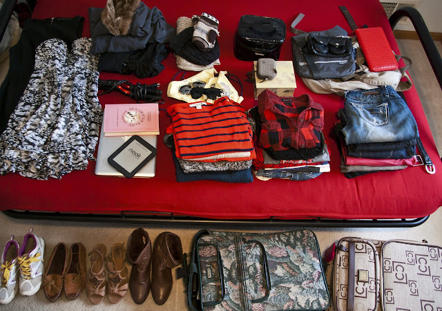 Clothes laid out for packing for studying abroad.