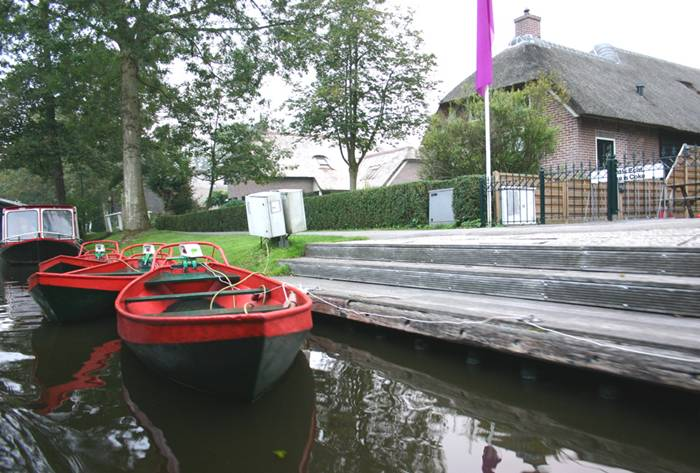 """All traffic has to go over the water, and it is done in so-called """"punters"""", called 'whisper-boats' as they are driven by an electric motor, so they barely disturb the peace and quiet in this scenic little village."""