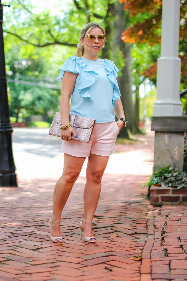 pastel high-rise shorts and ruffled baby blue blouse
