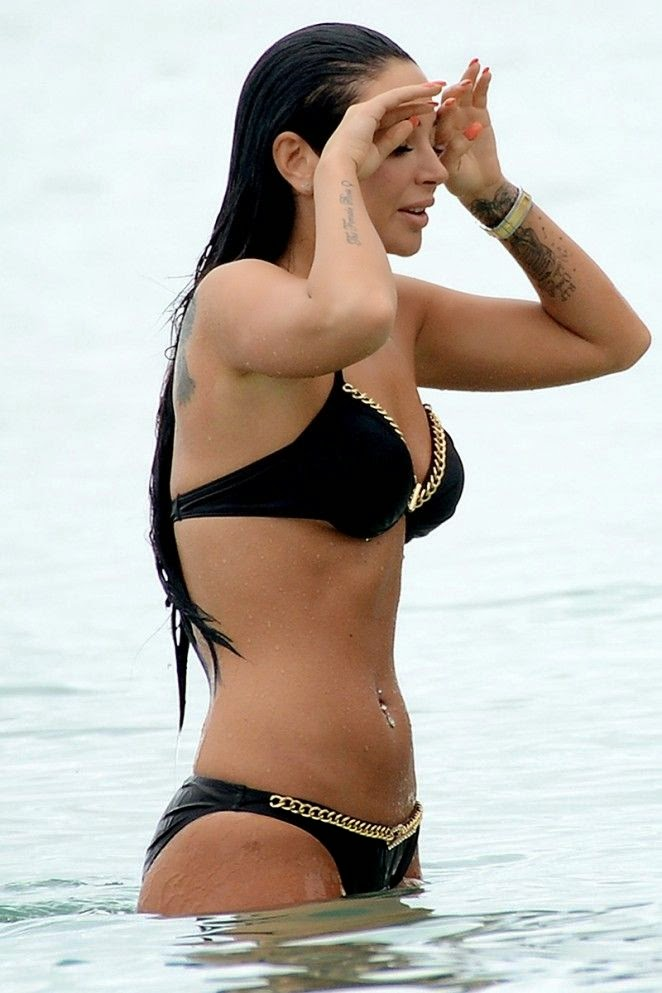 Who knew that under all those layers of fabulous designer, Tulisa Contostavlos was hiding a seriously toned figure?  The singer flashed her incredible anatomy while spending her last holiday on the New Year's Eve 2015 period at Barbados on Thursday, December 30, 2014.