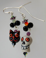 Skull and Black Cat Halloween earrings with crystals and porcelain handmade beads.