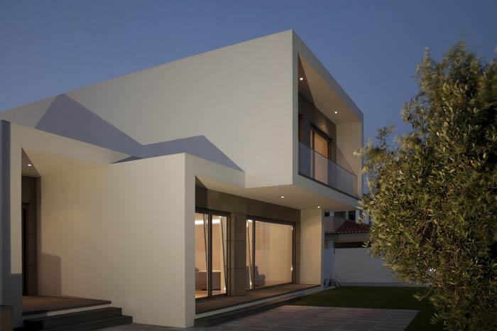 Casas minimalistas y modernas casa moderna en portugal for Fachadas de casas modernas entre medianeras