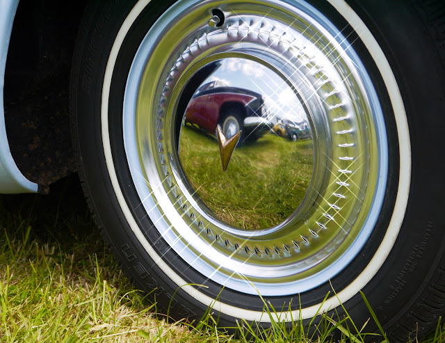 Gleaming wheel hub on a vintage car