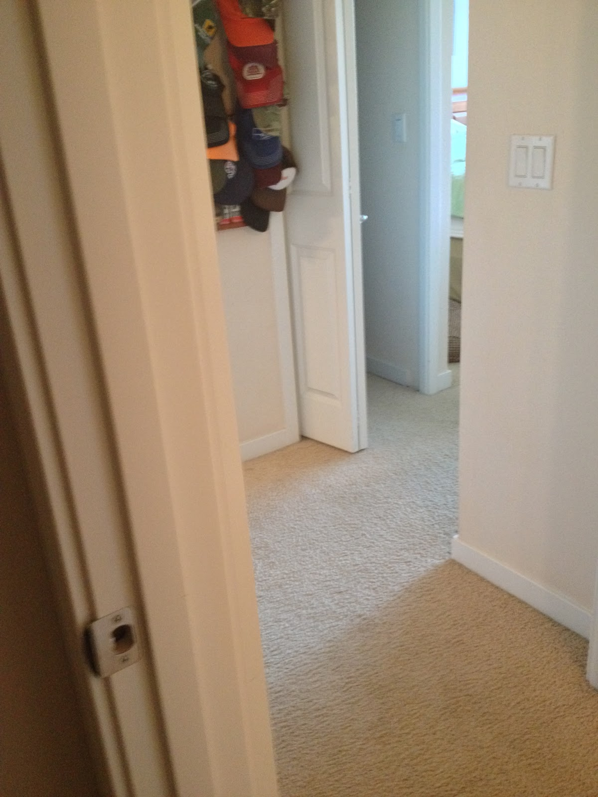 Looking from the guest bathroom into the master bedroom hall (the open title=
