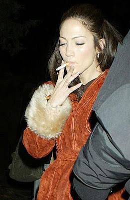Jennifer Lopez smoking a huge cigar.