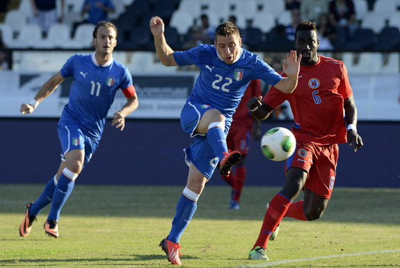 Italy player Emanuele Giaccherini scores his side's first goal against Haiti