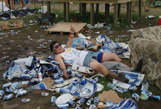 funny picture: Drunk guy enjoying the garbage