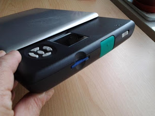 Shiney thing from the side, as it says in the caption you can see the blue card in the slot, the large green scan button and the smaller grey slide button for the power.