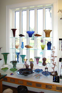 Handmade and blown glass from Arkansas glass artisans on display