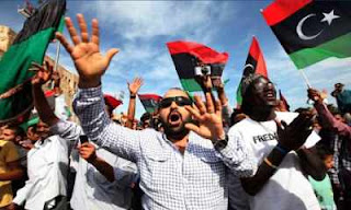 Libyan's celebrating Gaddaffi's death