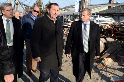 Enda Kenny (right) walks with Breezy Point locals viewing the destruction in the Rockaways caused by Superstorm Sandy (Photo:  James Higgins)