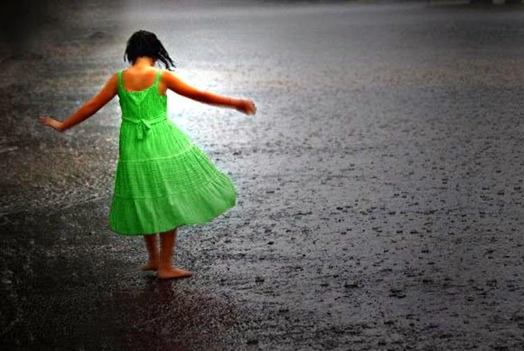 Girl Dances in Rain