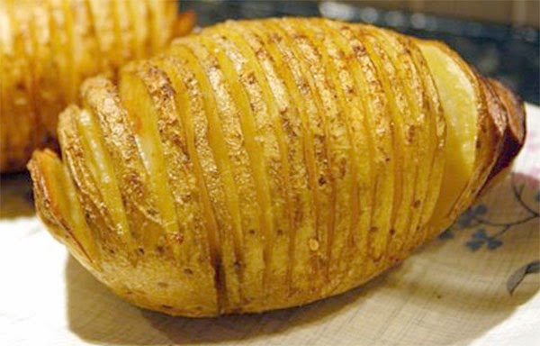 Spicy Hasselback Potatoes: Part-sliced potatoes, basted with butter and finished with a spicy topping