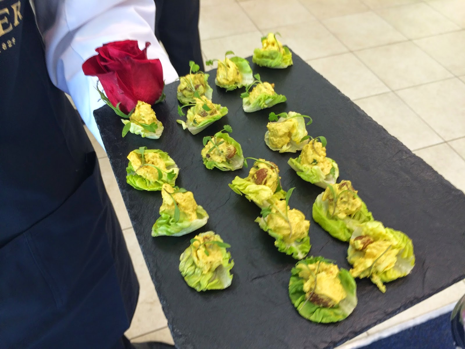 Coronation chicken on a baby gem leaf