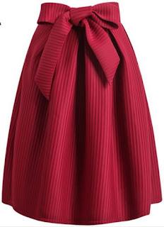 Falda vintage plisada hasta las rodillas con un gran lazo en la parte central