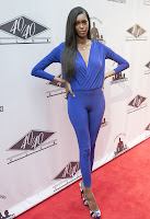 Jessica White in purple leggings on the red carpet