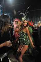 Miranda Kerr posing for cameras in a skimpy green outfit