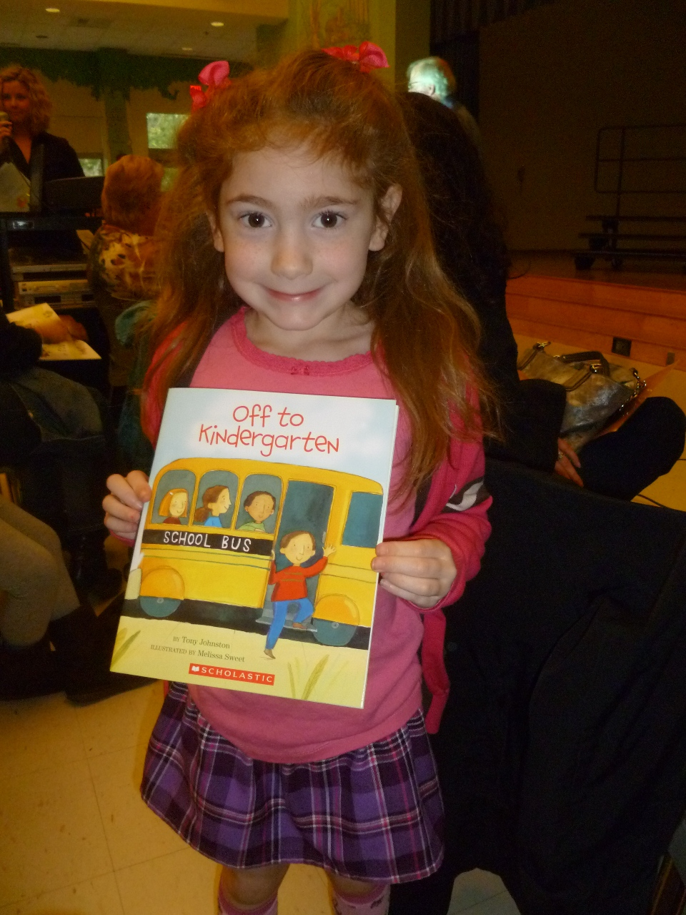 kindergarten girl side Today we had Kindergarten orientation. They called all the kids up on the stage to listen to a story. Lauren saw many friends from preschool, ...