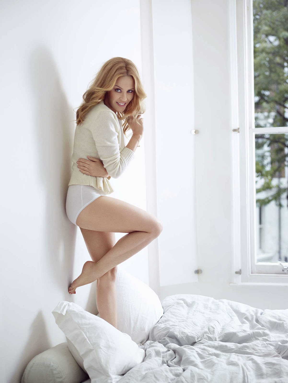 Kylie Minogue pose in Sloggi Underwear for the Fall/Winter 2014 Campaign
