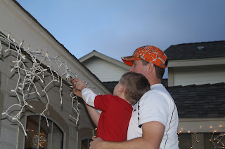 Lovin this life hanging christmas lights brent hang christmas lights there were a few burnt out bulbs that they had to fix braden hurried and got his tools and they fixed them together publicscrutiny Image collections