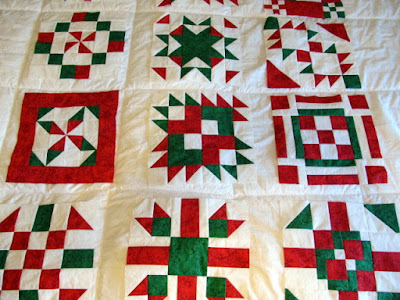 A HOLIDAY Quilt Pattern digital download in red and green fabric.