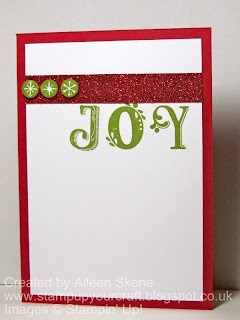A Christmas card using Stampin Up's Broadsheet Alphabet for JOY and Red Glimmer paper