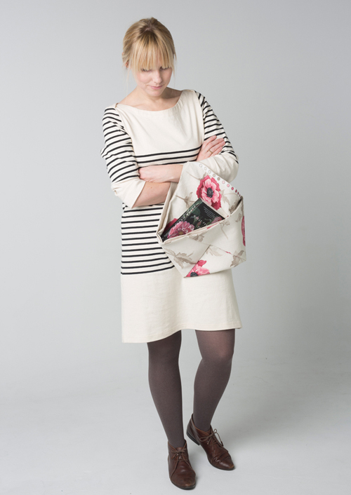 Model holding origami-style fabric tote bag
