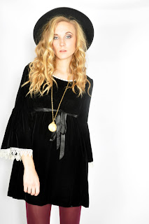 Vintage 1960's black velvet bell-sleeved mod style mini dress with white lace trim.