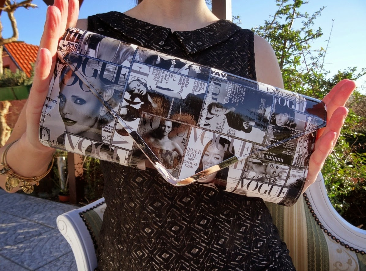 Magazine clutch as part of outfit post
