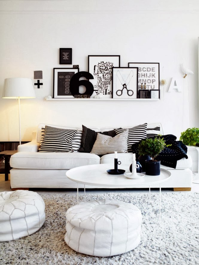 Living room interior design with black and white furniture for Interior decoration designs living room
