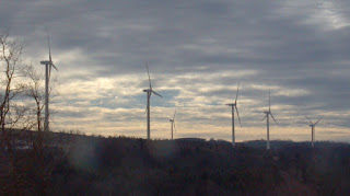 six wind turbines on a hill in pennsylvania
