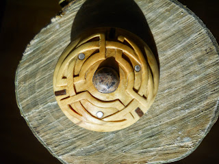 carved wooden kiltpin with inset stone