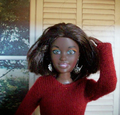 Kenya World Beverly Hills doll with her hair cut above her shoulders